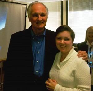 Alan Alda with short, brown haired girl.