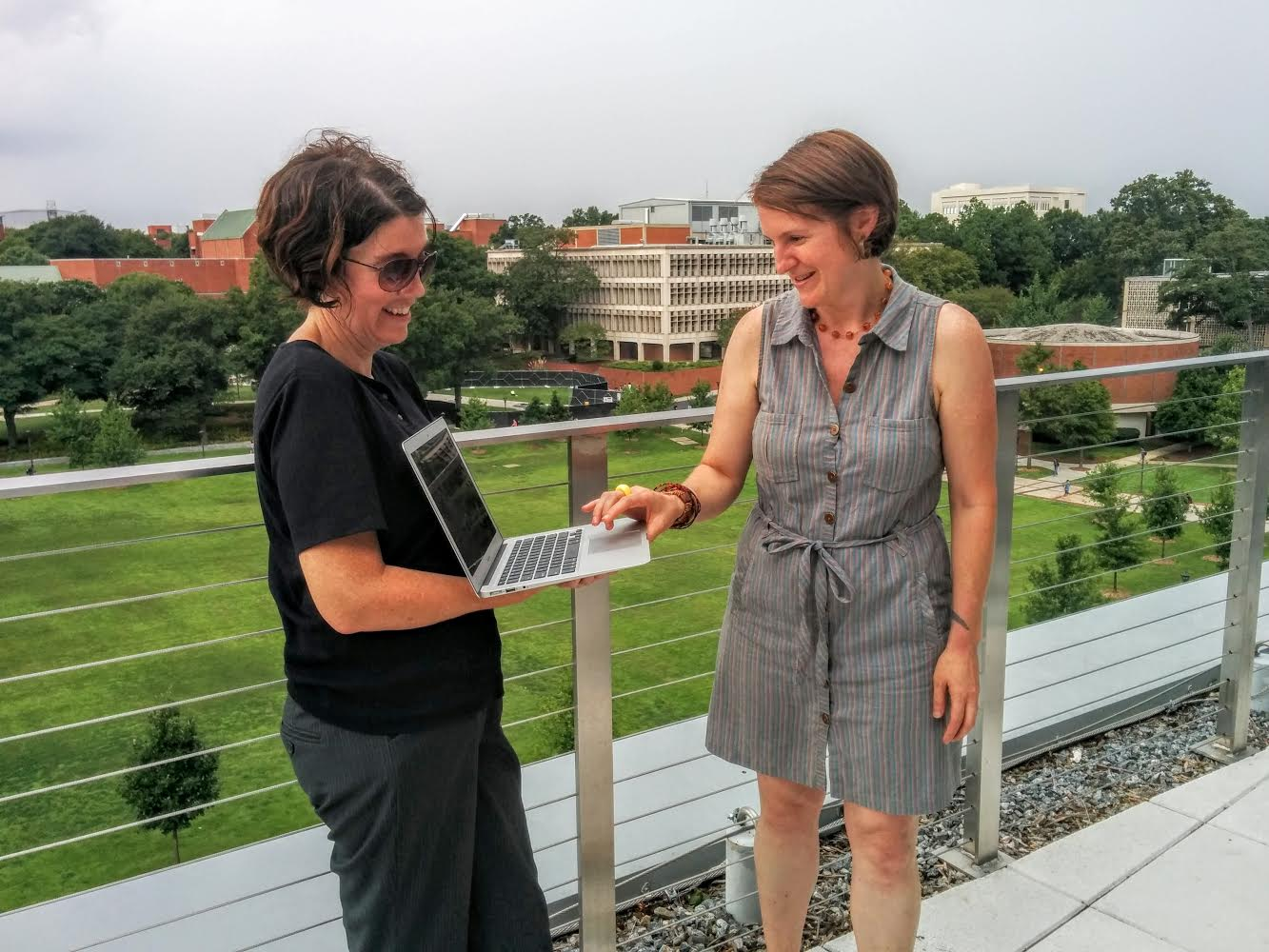 Brittain Fellow Lauren Neefe (2014-present) clicks the button to officially launch 4:33@Tech. Podcast co-founder Alison Valk holds the laptop.