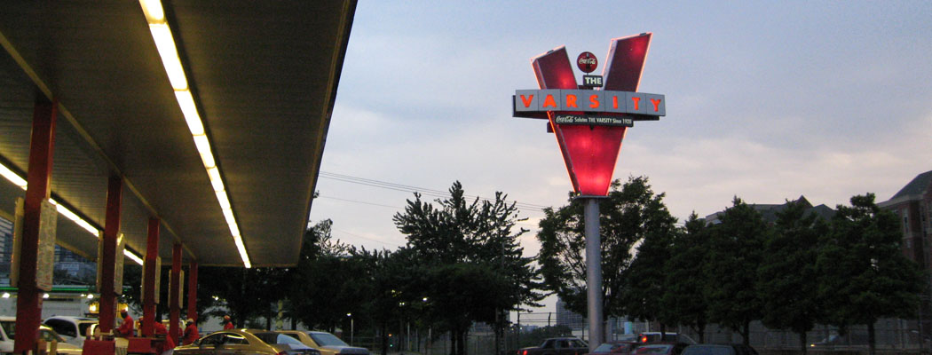 Twilight Photo of Neon Red Varsity Diner Sign