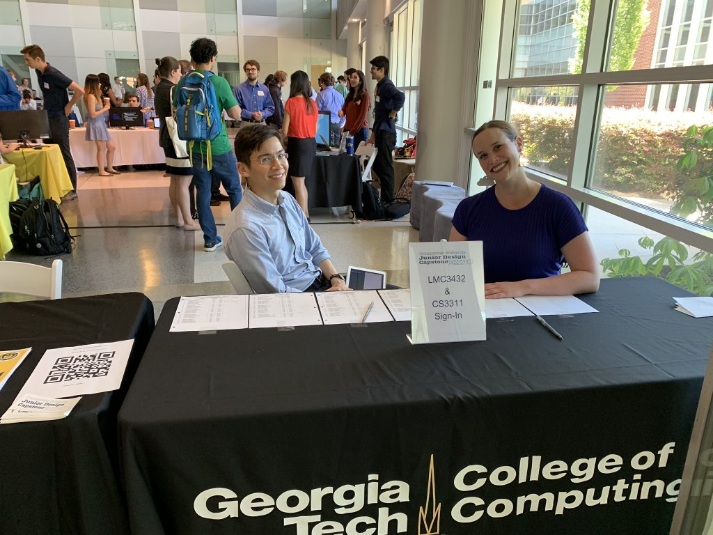 LMC 3432 instructors Jonathan Shelley and Katie Schaag greet attendees at the sign-in table at the Spring 2019 Expo