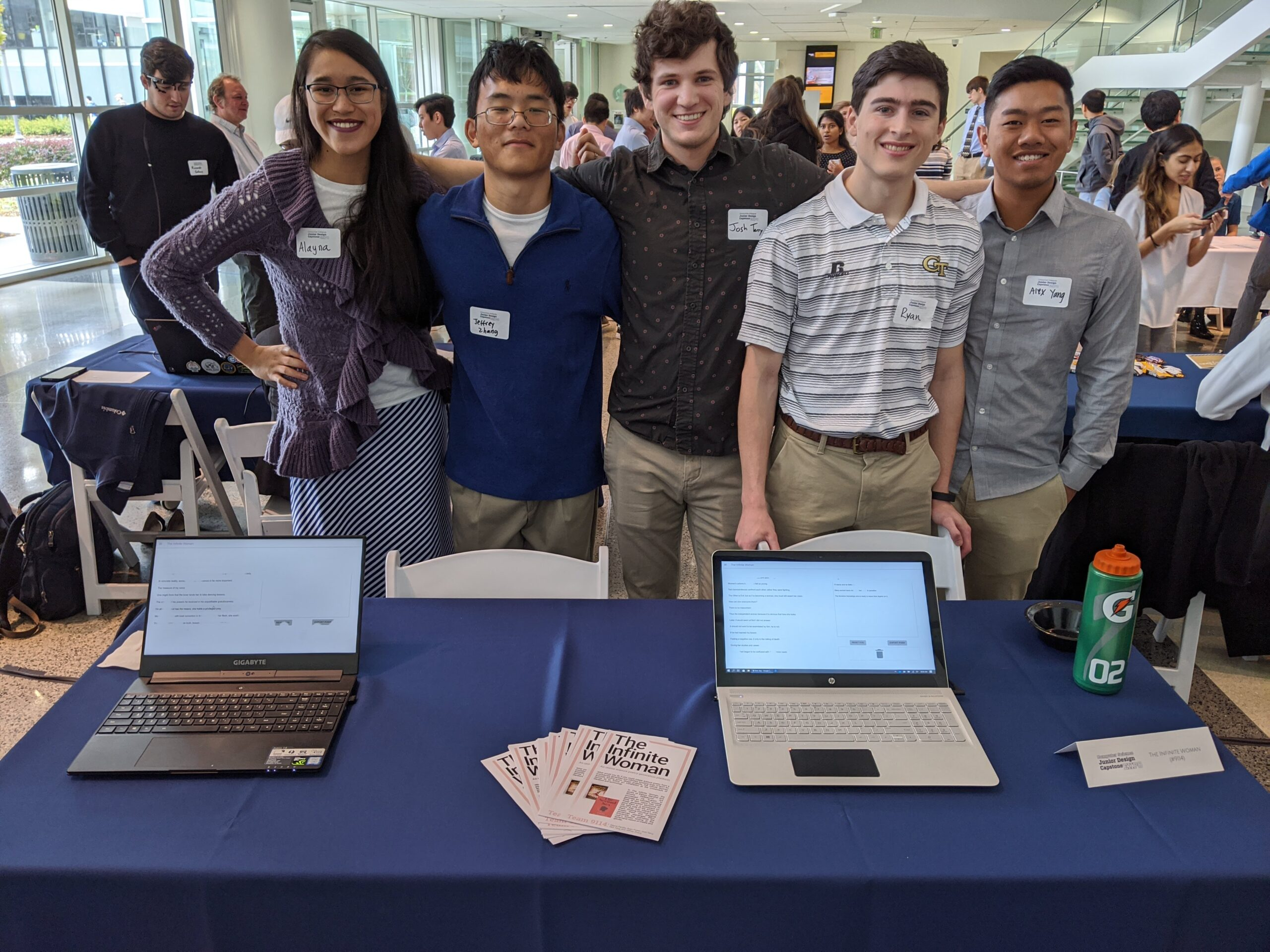 "The team (L-R: Alayna Panlilio, Jeffrey Zhang, Josh Terry, Ryan Power, Alex Yang) presents their project at Georgia Tech's <a href=""https://sites.gatech.edu/csjuniordesigncapstone/expo/"" target=""_blank"" rel=""noopener noreferrer"">Junior Design Capstone Expo</a> in December 2019. They stand smiling behind a table displaying brochures and the web app on two laptops."